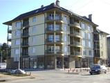 Жилищна сграда с магазини и гаражи в град Ботевград,   Цени от €32000
